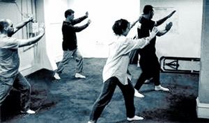 Picture of four people doing Tai Ji.